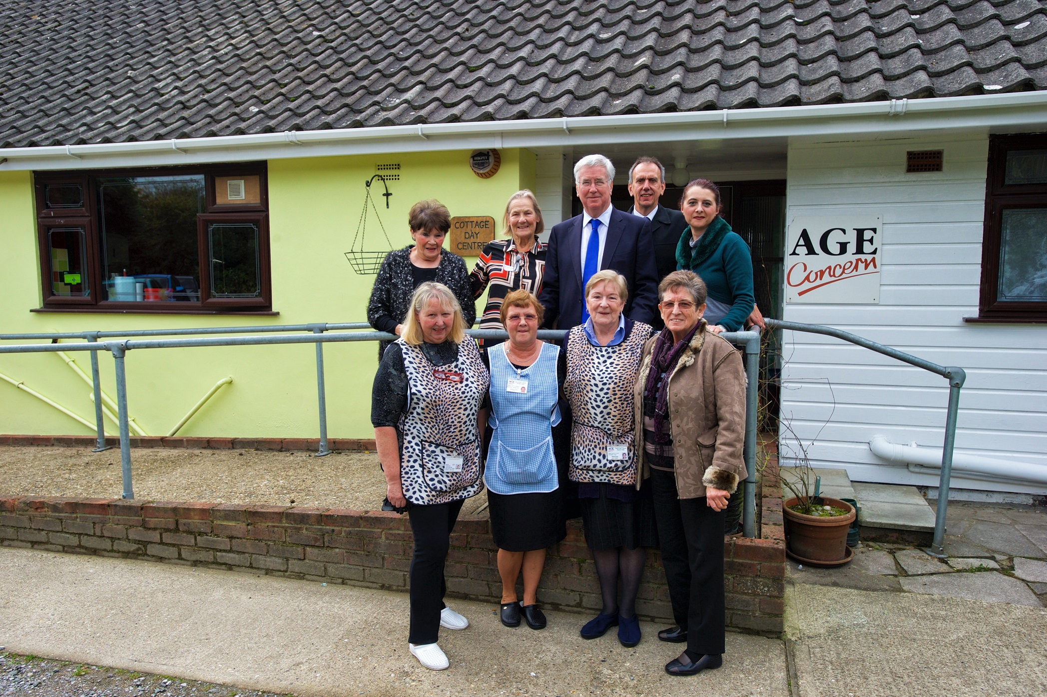 Michael with Trustees and staff outside the Cottage Day Centre