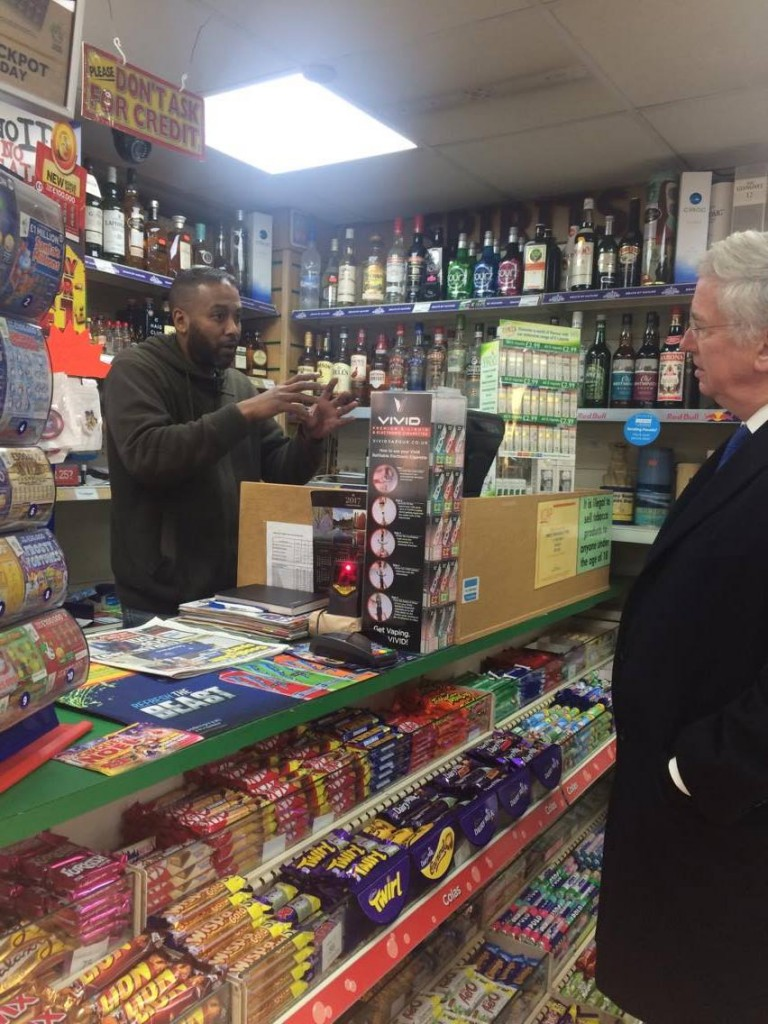 Michael speaking with Darren, owner of Towes Convinient Store