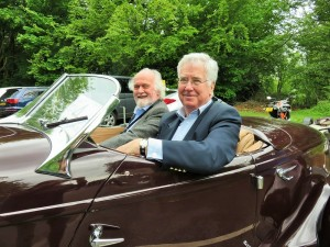 Sir Michael in a vintage Auburn Supercharged Speedster