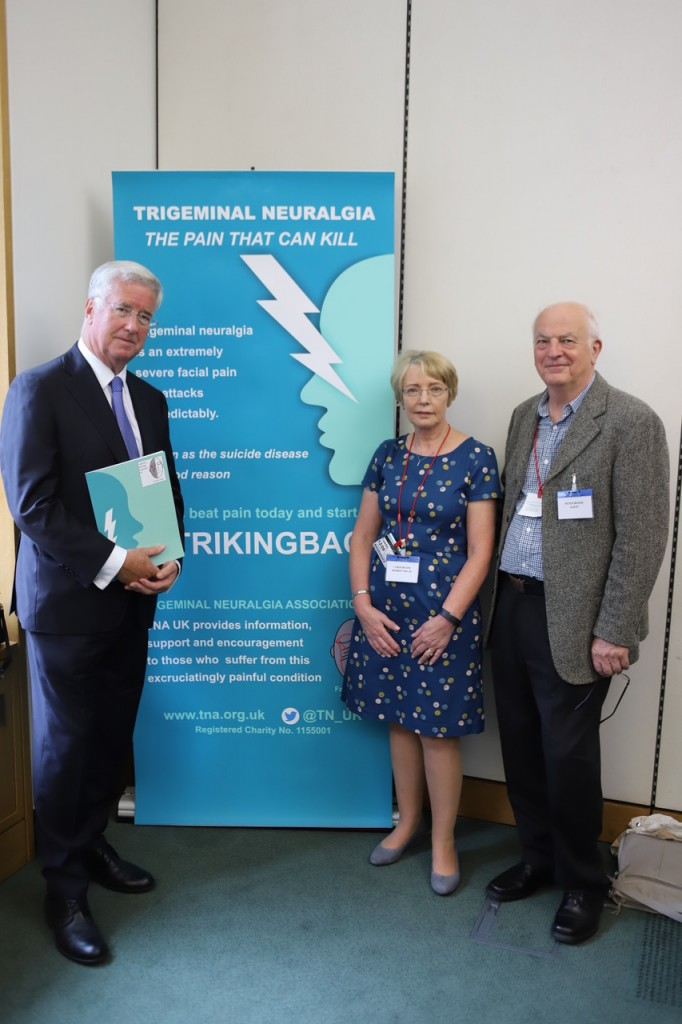 Sir Michael with constituents, Lynda Moore, who suffers from TN, and her husband, Peter, at the parliamentary reception.
